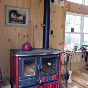 wood cook stove la nordica rosa maiolica bordeaux. Black Bedroom Furniture Sets. Home Design Ideas