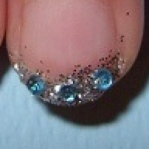 Bridal manicure with blue gems