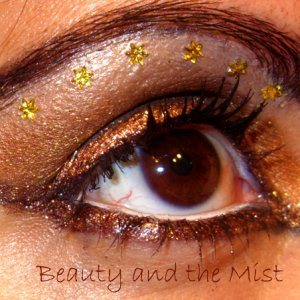 Eye makeup with gold colours and stars