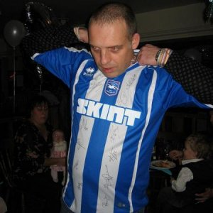 My hubby's 40th party. Has just been given a signed brighton shirt and decides to wear it in the pub. Was not happy cost me a fortune