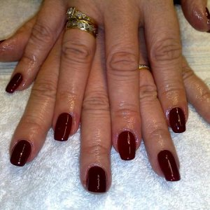 One of my regulars - her nails grow in all different shapes, some curl in at the side, some grow at an angle - and she will never let me do an overlay to correct the shape!! lol!