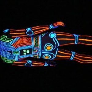 """""""UV Tron Cyborg"""". One of my favourite body paintings. Painted entirely using Kryolan UV make-up, and shot on a dark November evening with a professional UV cannon (as used for clubbing) as a light source."""