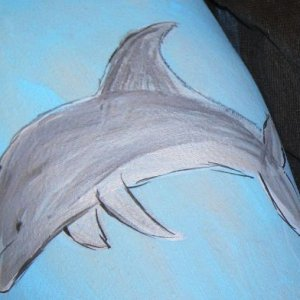 A dolphin on my model's thigh.
