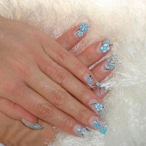 In-laid flower decals/hand painted N/A on sculpted glass tips.