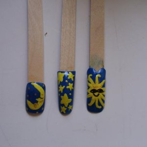 Hand painted sun and moon theme nail art.