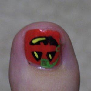 Hand painted pumpkin nail art.