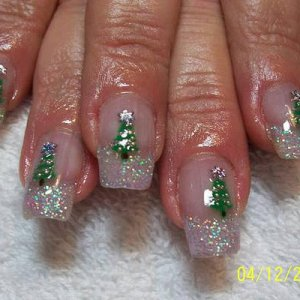 Snow coloured tips and trees!!  The trees on these nails have been airbrushed, then accented with sliver glitter, silver bullion and an AB Snowflake rhinestone. The nails are an overlay of L&P, the tips are Creative's perfect clear and Pronails glitter, zones 2&3 are perfect clear.