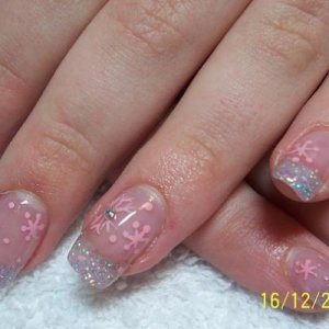 Pink Snowflakes and Glitter Acrylic  The glitter tips are Pronails pastel blue glitter mixed with Creative's Perfect clear acrylic, the snowflakes and snow is hand painted with pink acrylic paint.