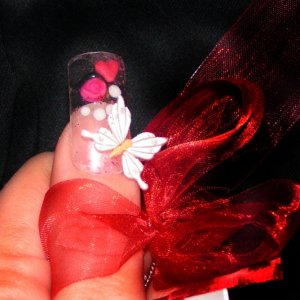 My entry Valentine comp  Embedded 3d rose in gel with 3d heart and butterfly.