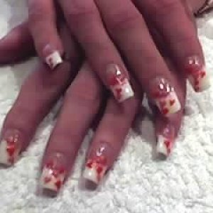 3D valentine nails  Full set of pink and white acrylic nails using the competition serise . 3D valentine hearts have been applied after/
