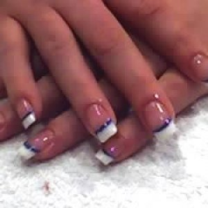French Tips with glitter blue acrylic stripe  full set of pinks and white acrylics with a glittered blue stripe accross.