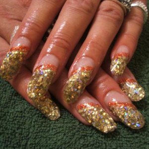 this client always goes OTT this with gold glitter with an orange glitter stripe over NNO She loves them long.