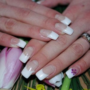 Spring time nails!  French white gel nails, sculpted. Also using coloured gel, I painted the little flower on the pinky for an added touch!