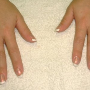 Natural Nail French Manicure Upclose  Natural nail french manicure done on a bride using China Glaze Ooh La La White & Soft Pink Pearl.