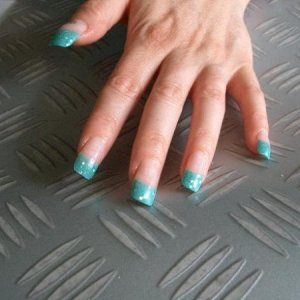 Turquoise glitter tips  Turquoise tips with boogie nights glitter acrylic for a touch of extra glamour for a reverse french.