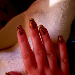first set of airbrushed design on myself  Going out tonight, so thought I would have a go at jazzing up my nails with the airbrush, it was really hard to keep the  stencil in place though. xx
