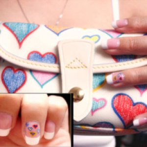 Dooney and Bourke Hearts  I'm a newbie licensed Nail Tech. I just painted DB HEARTS on my ring finger so it would match my DB Handbags. My nails are just plain french manicure because I don't like having acrylic on my nails. Anywho, tell me what you think of it. =D