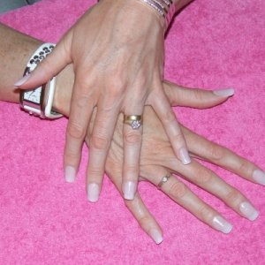 sheer pink acrylic nail tips  another pic so my clients can see what the after results are ,im just qualified a few months ,so doing my own nails helps me advertise and get me to pratice too