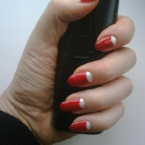 Copied from advert in The Guild magazine. Bio Sculpture 2037 (Bridal gown) on half moons, with 63 (Moulin Rouge) on nail bed with a thin coat of 19 (Pillar Box Red) and Northern Lights Gold holographic top coat.