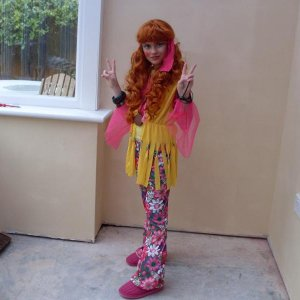 Paige in her 70`s hippy chick outfit.