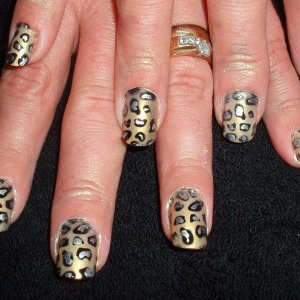 Poppit application, leopard print airbrushed design, before they were actually washed around the edges. she'd had minx toes done too, same design