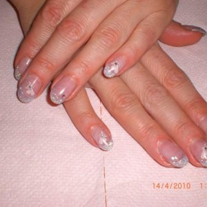 youngs nails glitter lilac.. mixed with clear acrylic heart and diamonte encased gems