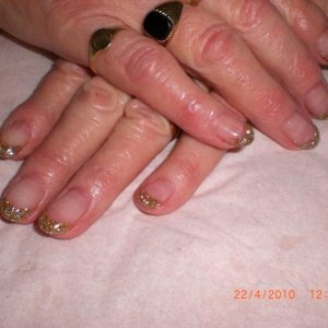 my cute as a button 82 yr old client! bless her always has the same gold glitter acrylic !  she loves them!!
