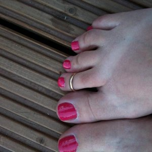 my toes painted with pink