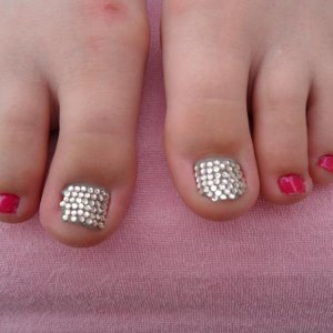 My first attempt at crystal pedicure on daughters not so good toes