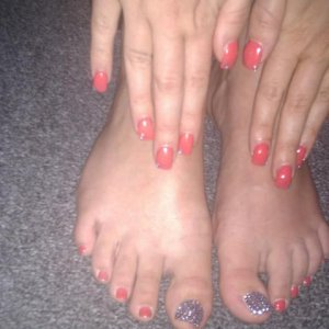 Nails done usingCND Electric Orange and big toes blinged up.
