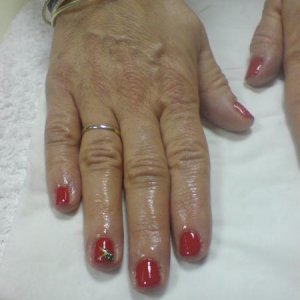 red bio S with green nail art