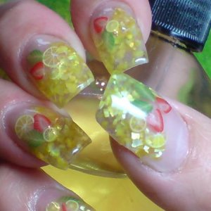 my nails with crushed shells and mini fruits
