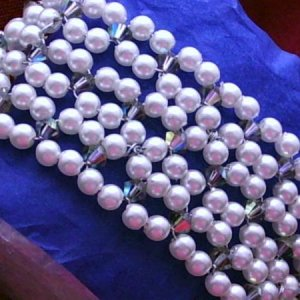Swarovski pearl cuff style bracelet incorporating Swarovski crystals for a bit of sparkle.