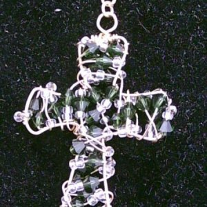 This is a sterling silver cross incorporating emerald Swarovski crystals and seed beads made for a lady in Ireland.