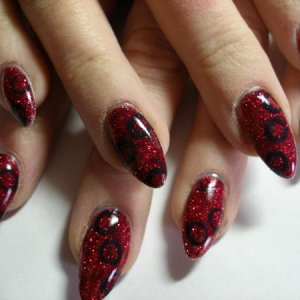 Red glitter with black circles