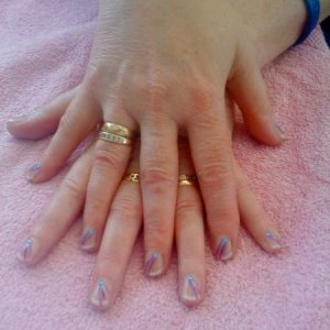 Nail art (flicks with gems)