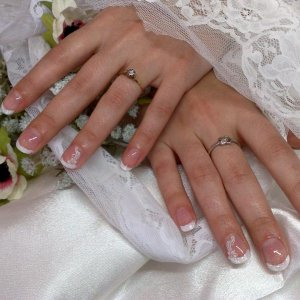 natural nails, with french and a sprinkle of glitter and nailtopia decals. Amanda got married next day at Gretna Green.