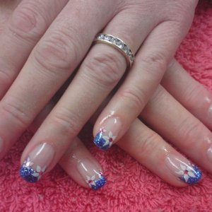 Blue glitter tips with flowers & diamontes
