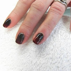 Gelish Black Shadow with Good Gossip glitter fade effect on natural nails.