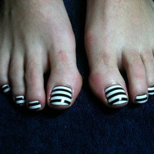 Minx Nail Armour: Black and White Stripes Design. Applied by Gemma Pinfield-Thomas of Up To Scratch Nails, Warwickshire, England.  www.uptoscratchnails.com