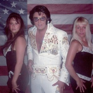 Me on the left my brother as Elvis and his wife Melanie to the right.
