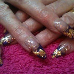 Mixture of Young Nails and Nfu oh glitters with some gold leaf.  These are 2 weeks old and ready for infills!