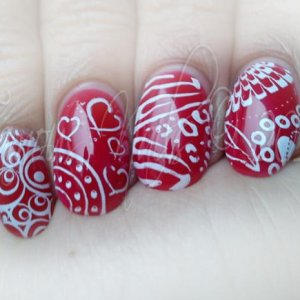 Got sick of the flower pattern and decided to have a change. Ended up with several different patterns, lol :P Love the high gloss shine from the Polish Pro topcoat, though!
