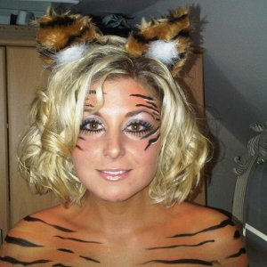 tiger close up, double strip lashes to make a more feline eye shape