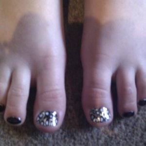 Silver lightning cheetah minx + OPI lady in black on my youngest client (7yrs old)