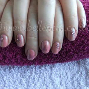 My first proper go at Konad!!!! Rose Bud and Iced Corel Shellac with Konad stamp and crystals