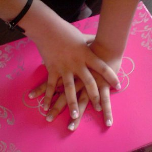 white tips acrylics, pink and silver glitter flicks pearl and rhinestones on ring fingers and thumbs