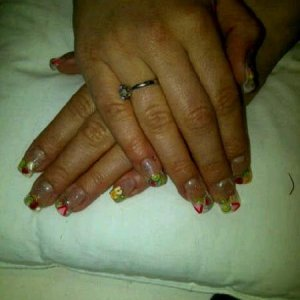 tutti fruiti uv gel sculptured nails close up - clear gel encapsulating fruity fimo slices (she was trying to stop smoking-hence the bad cuticle biting-ouchy!!)