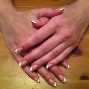 First attempt at a French manicue.  I used two coats of Negligee and one coat of Cream Puff. Sorry about the grainy picture, it was taken with a camrea phone and email to me by my client