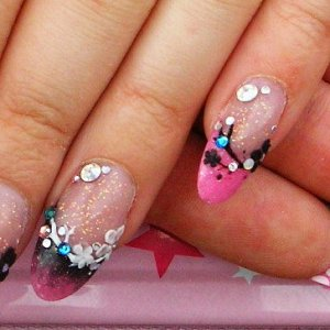 Pink and black l&p with handpianted and sculpted flowers, circles underneath tips
